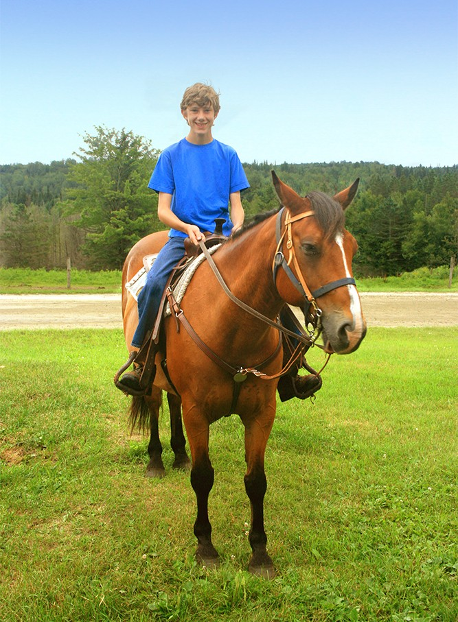 Teenage boy on horse